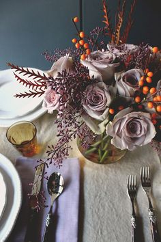 Lavender, purple, mauve + burnt orange in fall tablescape. Smoky Blue/Teal wall makes it work.