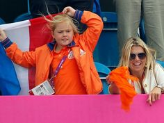 Princess Maxim of the Netherlands, right, and her daughter, Princess Amalia, celebrate a Dutch win over China in women's field hockey at the Riverbank Arena on Aug. 2