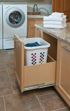 Custom rollout for laundry basket in mudroom/laundry room. Crown Point Cabinetry Gallery Custom rollout for laundry basket in mudroom/laundry room. Mudroom Laundry Room, Laundry Bin, Laundry Storage, Laundry In Bathroom, Bathroom Storage, Laundry Baskets, Hidden Storage, Bathroom Closet, Laundry Shoot