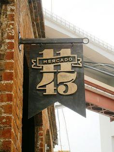 Raised letters on black steel sign