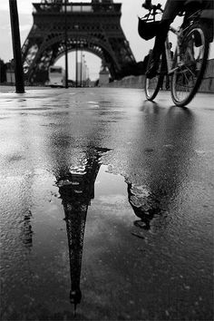 Paris | Unknown Source | reflection | eiffel tower | bicycle | rain | cycle | transport | vintage black & white photography | architecture | design | brilliant composition | winter | gloomy | beauty |