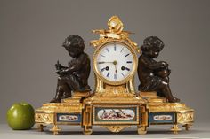 A Napoleon III ormolu mantel clock in Louis XVI style decorated with military attributes and two patinated bronze putti sitting on books representing and allegory of the arts. Oval base... 4,500€