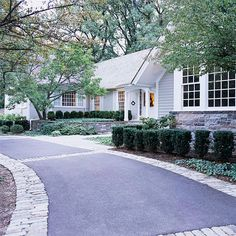 Dress up the driveway  If your driveway is cracked or stained or has vegetation sprouting from it, you can upgrade it without doing a complete redo. First repair the cracks and stains (and kill the weeds), then dress it up by staining the concrete or affixing flagstones. If you need more room to move your car or park, add stone, brick, or pavers to the sides of the drive to widen it with flair.
