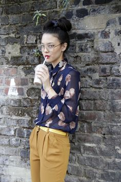 loving this style. the printed sheer floral blouse, those mustard pants highlighted with that sunkissed yellow belt. nice!