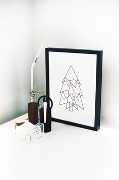 Who said that minimal can't be festive? This elegant sophisticated Christmas tree print with rose gold accents definitely is a mood setter.  #christmas #minimal #geometric #print #wallart #decor #interior #inspiration #holidaydecor #giftideas #christmasdecorations #festive #rosegold #blackandwhite