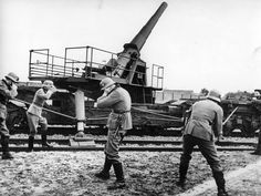 German gun crew ready to fire a railway gun; everybody but the man to pull the lanyard have sealed their ears. The 170mm cannon weighed 80 tons and could hurl a projectile at targets as far away as 26 km. The photo was taken during the invasion of Poland, Sept 1939.