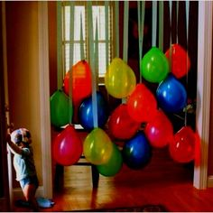 Stole this idea from another pinterest post....Hung balloons upside down using streamers.... Gave me a great pic of the birthday boy waiting for his party guests!! 1st-birthday-yo-gabba-gabba-style by Evelyn GoGettah Jasper