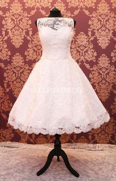 This is *the* dress.  It's so beautiful...lace, sweetheart neckline, tea-length, scalloped lace bottom.  That's the recipe for my perfect wedding dress.  retro 50s