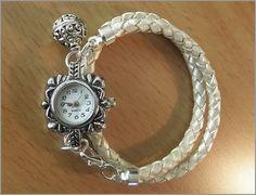 Reloj de  pulsera  de cuero trenzado plata.ninna