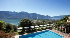 Featuring an outdoor pool with panoramic views over Lake Maggiore, this elegant Villa enjoys a privileged location above Locarno. Switzerland Hotels, Villa, Outdoor Pool, Outdoor Decor, Small Luxury Hotels, 5 Star Hotels, Places, Travel, Pools