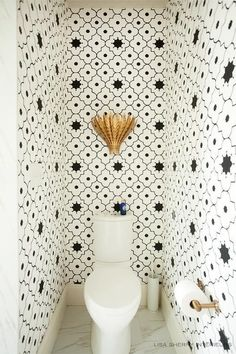 Our toilet room! Taj Trellis Noir Wallpaper frames this small powder room allowing for black and white Moroccan walls to creates a larger decorative illusion. Gold Wallpaper Bathroom, Powder Room Wallpaper, Of Wallpaper, Moroccan Wallpaper, Trellis Wallpaper, Half Bathroom Wallpaper, Wallpaper Toilet, Mosaic Wallpaper, Wallpaper Designs