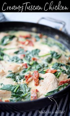 Creamy Tuscan Chicken made with boneless chicken pan seared in a skillet tossed with fresh spinach and sun dried tomatoes in an alfredo sauce. #chicken