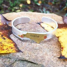 "Handcrafted stamped metal North Carolina ""home"" cuff bracelet by WildArrowStudio on Etsy https://www.etsy.com/listing/250446507/handcrafted-stamped-metal-north-carolina"