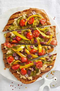 Did someone say pizza party? Homemade dough, a savory ricotta-like bean spread, and fresh pesto make these tasty flatbreads feel like an extra special treat. If you're cooking with guests, let everyone mix and match which veggies they put on top! Feel free to use anything that's in season, and drizzle with balsamic vinegar just before serving for a flavorful finishing touch. Vegan Pesto, Vegan Pizza, Vegan Casserole, Pesto Pizza, Cooking Courses, Loaded Baked Potatoes, Pizza Party, Vegan Baking, Balsamic Vinegar