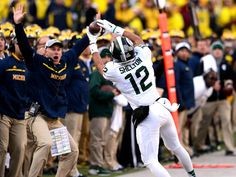 R.J. Shelton catches a Connor Cook pass on the sidelines during the third quarter of the Spartans' 27-23 victory over Michigan Saturday, October 17, 2015, in Michigan Stadium. The play was originally rule incomplete because he foot was close to being out of bounds, but that ruling was overturned after a review.   Dave Wasinger/Lansing State Journal