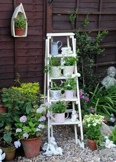 I love this ladder plant holder in white in a small garden off the patio.