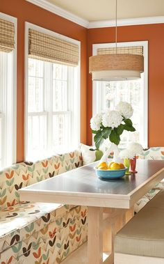 Not only do we love playful fabric and wall paint colour to match, but this is a great way to use a small space for a dining area!