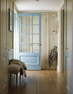 FARMHOUSE – INTERIOR – vintage early american farmhouse showcases raised panel walls, barn wood floor, exposed beamed ceiling, and a simple style for moulding and trim, like in this farmhouse entry hall with benjamin moore jamestown blue door color. Painted Interior Doors, Painted Doors, Interior Paint, Interior Design, Wooden Doors, Wide Plank Flooring, Wood Flooring, Flooring Ideas, Hardwood Floors
