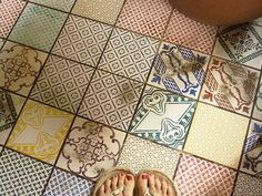 Vintage tiles! Love the quilt-like arrangement. This would be awesome for a second or half-bath.