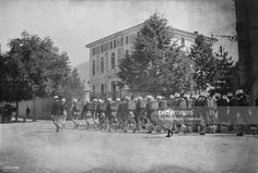 Soldiers of the French Foreign Legion marching through a French street with a…