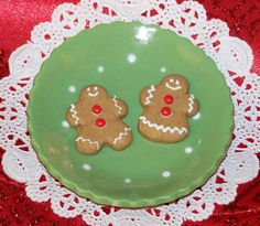 Gingerbread Boy & Girl Set - This cute little pair of gingerbread kids is the perfect combination of sweet and spicy!  Iced and decorated to perfection, your dolly will love biting their heads off first!  Set includes one boy and one girl cookie.