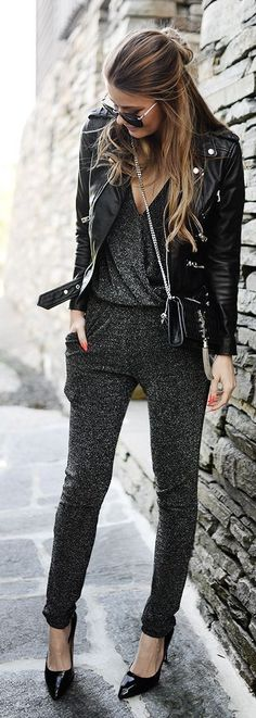 Silver jumpsuit with leather jacket.