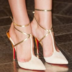 "Candice Swanepoel wearing Christian Louboutin ""T Slick"" pumps"