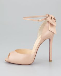 Christian Louboutin  Nude Peep-Toe Pump with the classic Red Soles