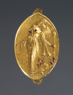 Greek -  Ring with dancing maenad, 400-300 BC. | ©J. Paul Getty Trust