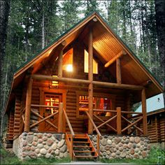 A-frame with stone foundation. Lovely light from the upstairs. I picture a loft. Cabins In The Woods, House In The Woods, Cabana, Stone Cabin, Log Cabin Homes, Log Cabins, A Frame Cabin, Little Cabin, Timber House
