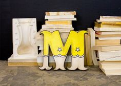 Distressed Carnival Style Wood Letter M Yellow and White via Etsy