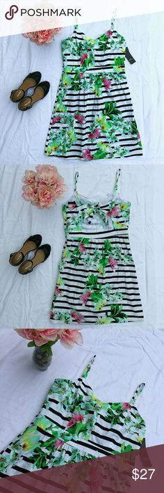 """NWT Black and White Striped R&K Dress Black and white stripes with colorful flowers; Fun and festive for the spring and summer.  Bust: 38-40"""" Waist: 34"""" Hips: Free length: 36"""" R&K Dresses"""