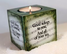 fun tea light holder - sheet music with Christmas song words printed on it