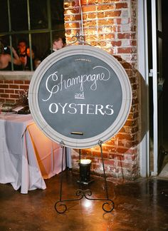 champagne and oysters chalk sign | Melissa Schollaert #wedding