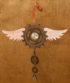 """Another """"gear"""" ornament idea; probably wouldn't put wings on it and clock face, as we're not trying to do the steampunk look; but this does give me the idea that some ornaments could link gears in a similar style."""