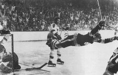 "Bobby Orr Flies After His Stanley Cup-Winning Goal - In 1970 Bobby Orr scored an overtime goal to give the Boston Bruins their first Stanley Cup since 1941. Seconds after scoring what has now been dubbed ""The Goal"" Orr tripped, but it didn't stop him from celebrating. It resulted in this, one of the most famous and joy-filled sports photos of all time."
