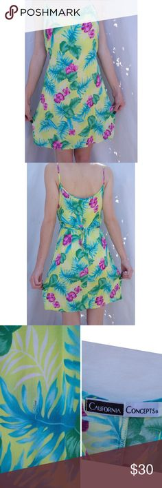 Vintage Colorful Tropical Flowers Tank Dress Vintage. California Concepts brand. Adjustable tie in back, no size but fits XS/S/M. Bright colorful pattern with tropical palm and flowers. Tank style dress, Midi length, about Mid-thigh above knee. Good condition minimal wear only significant flaw is featured in 3rd picture a small hole in back a little below where the tie is. Barely noticeable when worn and could be repaired with a few small stitches. FREE SURPRISE GIFT WITH EVERY ORDER! Fast…