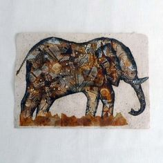 Animal pictures made of hand painted recycled tea bags on handmade paper.