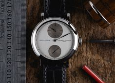 """""""Charmed"""" best describes the reaction that greeted Laurent Ferrier's wristwatch called the Montre Ecole, or """"School Piece"""". It represented the watchmaker's earliest development, returning to the basic pieces which forged his abilities as a watchmaker. It also possessed the qualities that would make it a """"watchmaker's watch,"""" minimalist yet complete. It was a watch that would speak to horologis"""