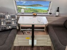 This is the dinette area in the CV6672SL Emerald caravan. You can optionally choose to upgrade the table into a tri-fold table so that it can be collapsed and extended to increase/reduce its size.