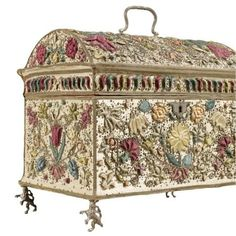 A Dutch embroidered, raised work and applique metal thread floral coffer, together with other accessories, first half 17th century. See post for further details....