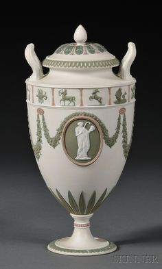Wedgwood Three-color Jasper Vase and Cover, England, late 19th century, white ground with applied lilac and green relief, a zodiac border above classical medallions between floral festoons.