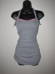 Custom T Shirt Dress w/ Built In Bra — Corset Inspired gray DIY cut couture backless halter shredded t shirt. $89.00, via Etsy.
