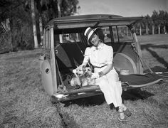Mrs. Stephen Sanford watching a polo match with her dogs at Delray Beach, 1950. #vintage #1950s #fashion