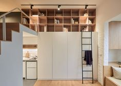 A bath, floor-to-ceiling storage and space for exercise are included in this compact flat, located in Taipei City, where property prices are driving young buyers into smaller homes.
