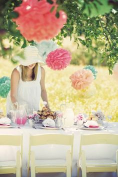 inexpensive poms poms add a romantic touch to a backyard wedding