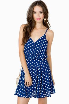 A swingin' day dress featuring a fun polka dot print and a blouson-style bodice. V-neck. Double spaghetti straps. Racerback. Finished short hem. Fully lined.