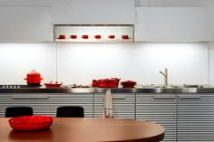 love the red in the kitchen w/ stainless steel appliances. another idea