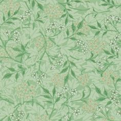 Jasmine Wallpaper 'Jasmine', designed in 1872 by William Morris, features a pattern of hawthorn leaves with blossoms and a meandering jasmine trail over the top in sage and leaf.