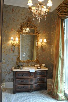 Beautiful powder room. Wallpaper is Jester Caprice in Pewter by Schumacher.